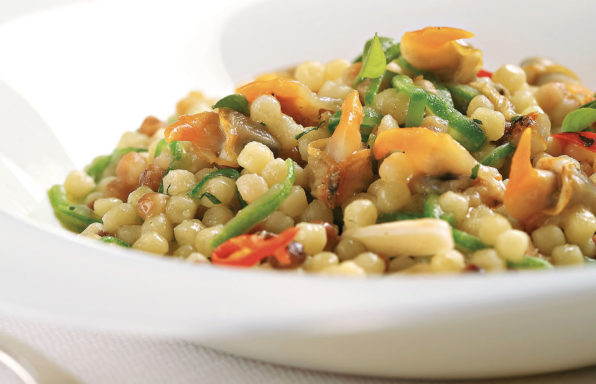 Fregola with clams, courgette, fresh almonds and chili pepper
